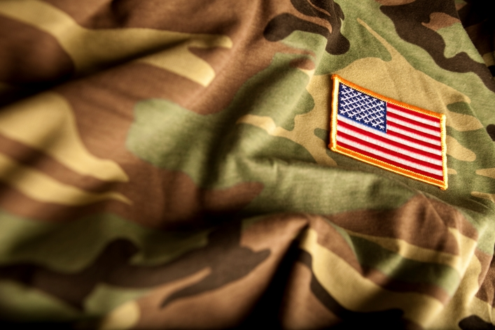 stock photo of army uniform and US flag